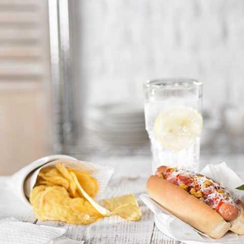 Corn, Parmesan and Hot Sauce on Rustica Sausage Bun