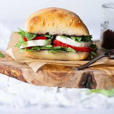 Tomato, Mozzarella and Basil on Gourmet Ciabatta Sliced Sandwich Roll