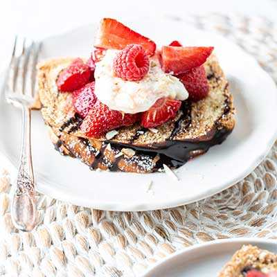 Whipped Cream and Strawberries on Double Chocolate Half Brioche Loaf
